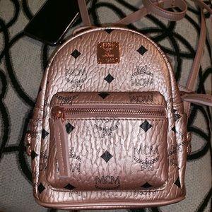 Mini mcm rose gold backpack